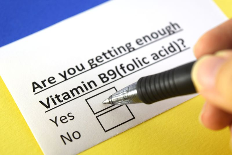 """pen hovering over checkboxes on question """"are you getting enough folic acid""""?"""