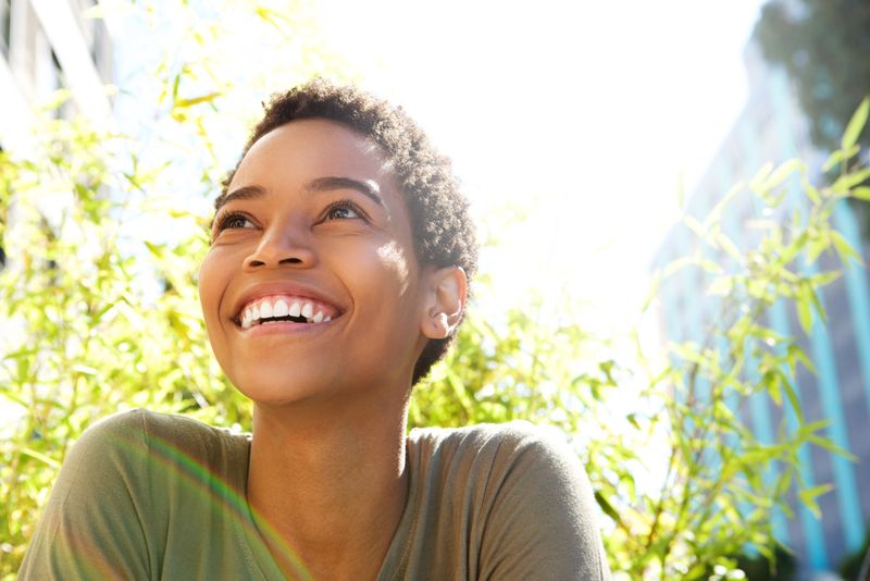 smiling woman in sunshine