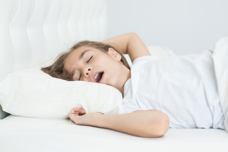 little girl sleep with her mouth open