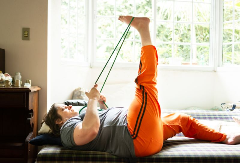 Woman practicing gym at home