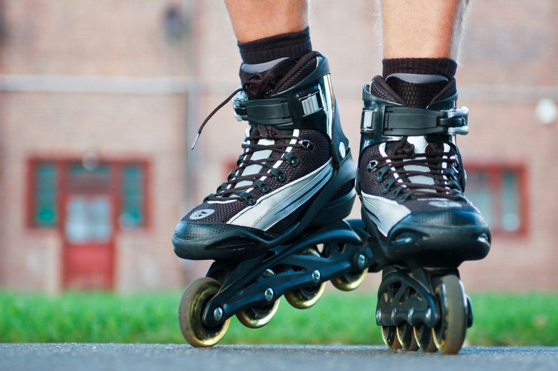 cropped image of a person rollerblading