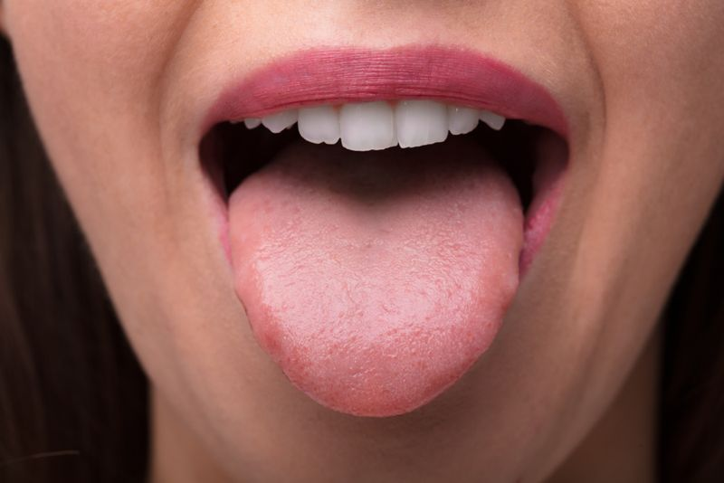cropped image of woman sticking her tongue out