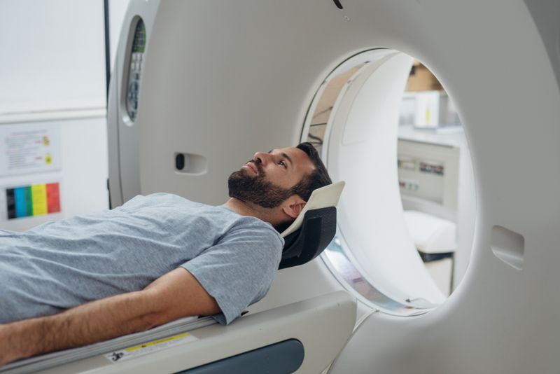 male patient entering a CT scan machine