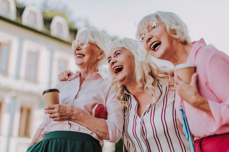 three older women, friends laughing together