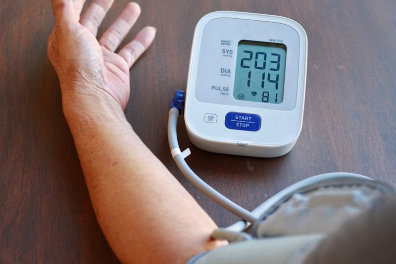 man taking blood pressure with very high reading