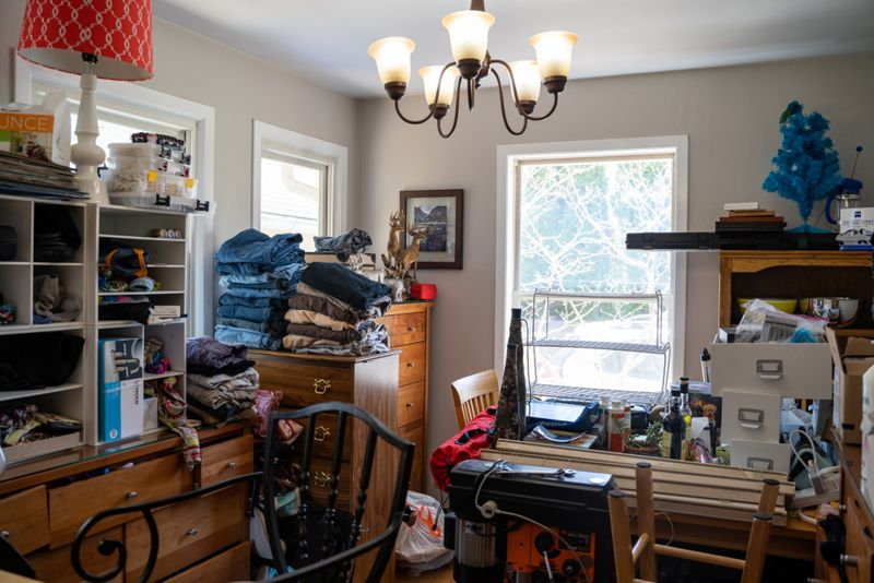 cluttered overfilled room in a hoarder's house