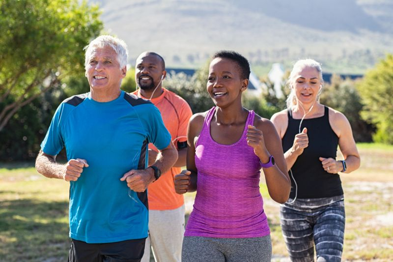 a group of middle-aged people jogging together