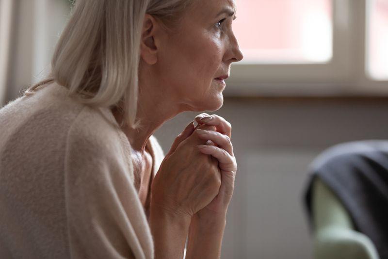 older woman looking anxious or afraid