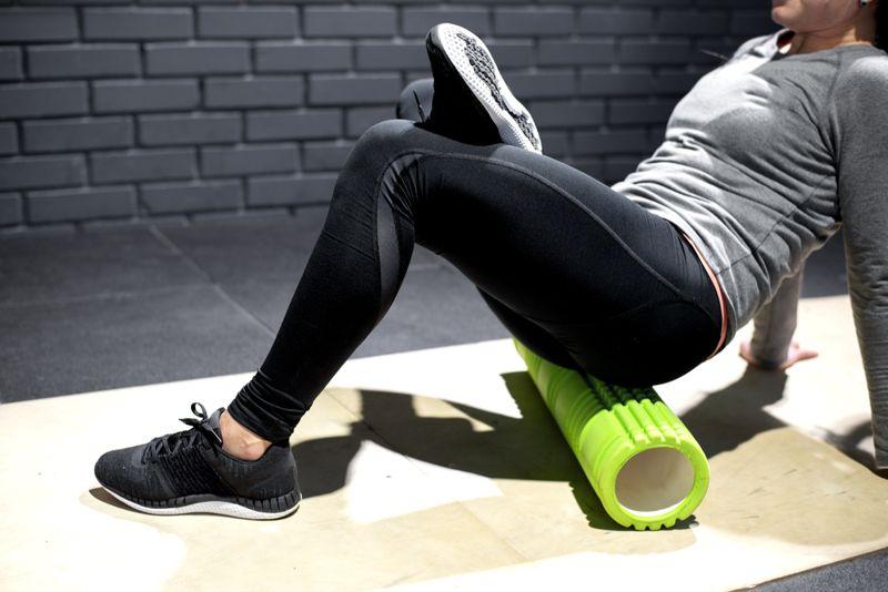 woman using a foam roller after a workout