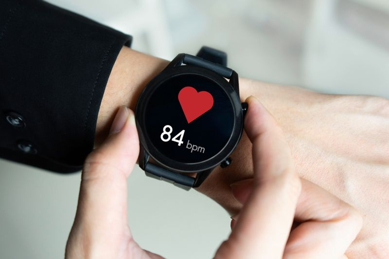 person checking their heart rate monitor; moderate pulse