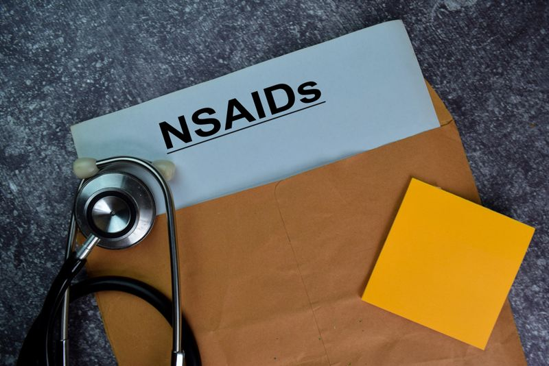 """official envelope with paper reading """"NSAIDs"""" and stethoscope"""