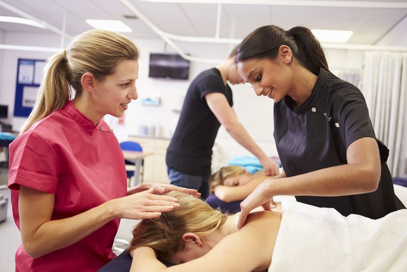 massage therapy student with teacher