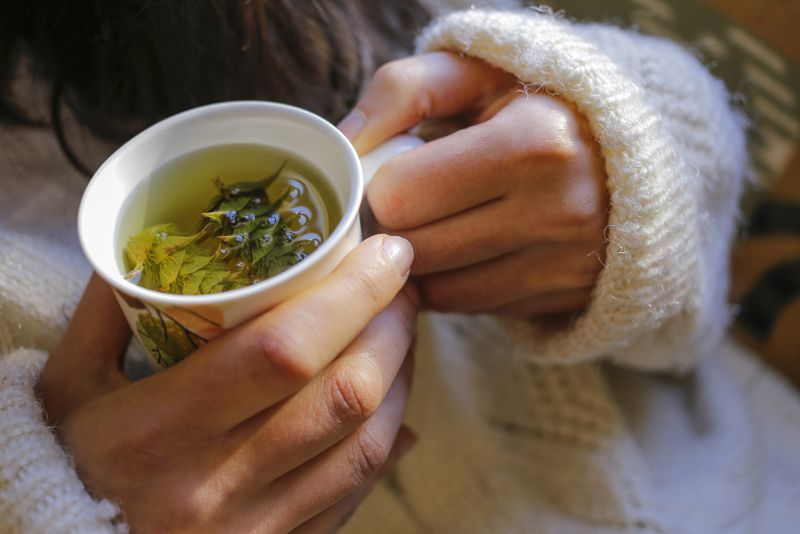 close up of woman drinking herbal tea