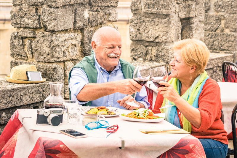 older couple dining on vacation