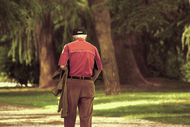 old man walking alone in the park