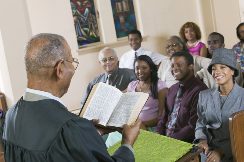 congregation listening to pastor read bible