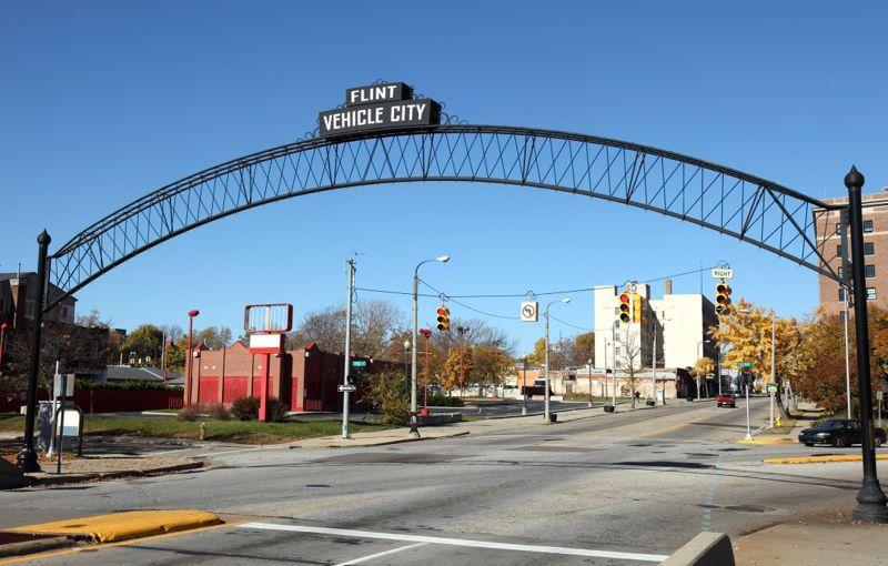 Flint Vehicle City sign entering downtown