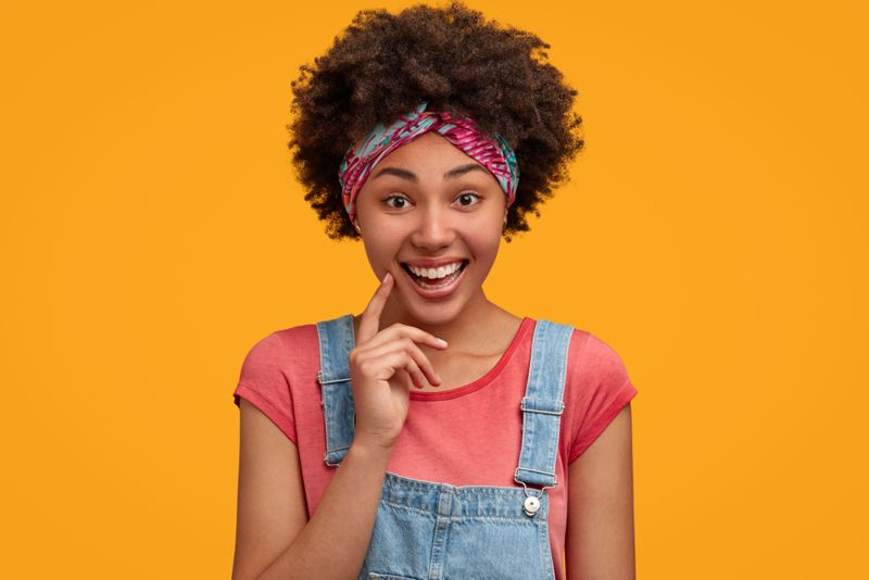 Cute happy hipster woman with positive expression
