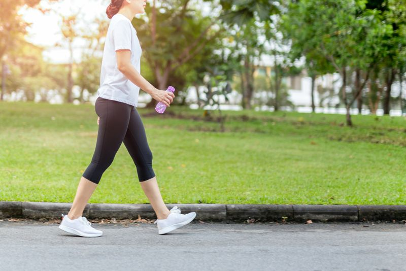 woman walking after a workout