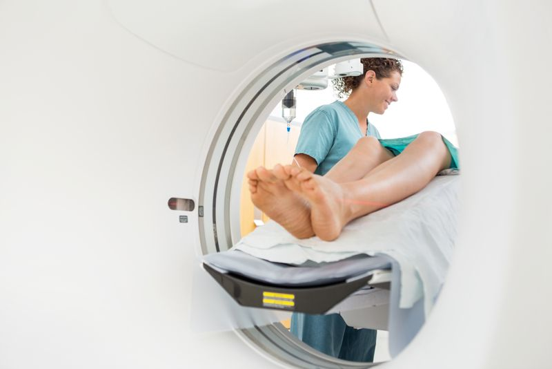 nurse checking on a patient about to get a CT scan
