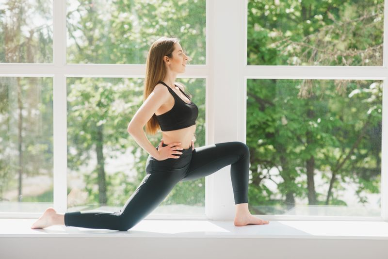 woman doing psoas or hip flexor stretch or low lunge