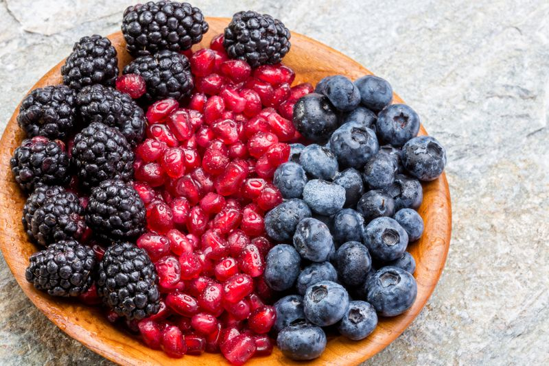 bowl of blueberries, blackberries, and pomegranate seeds
