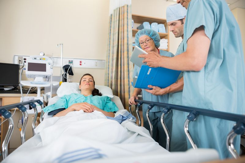 doctors preparing woman for surgery