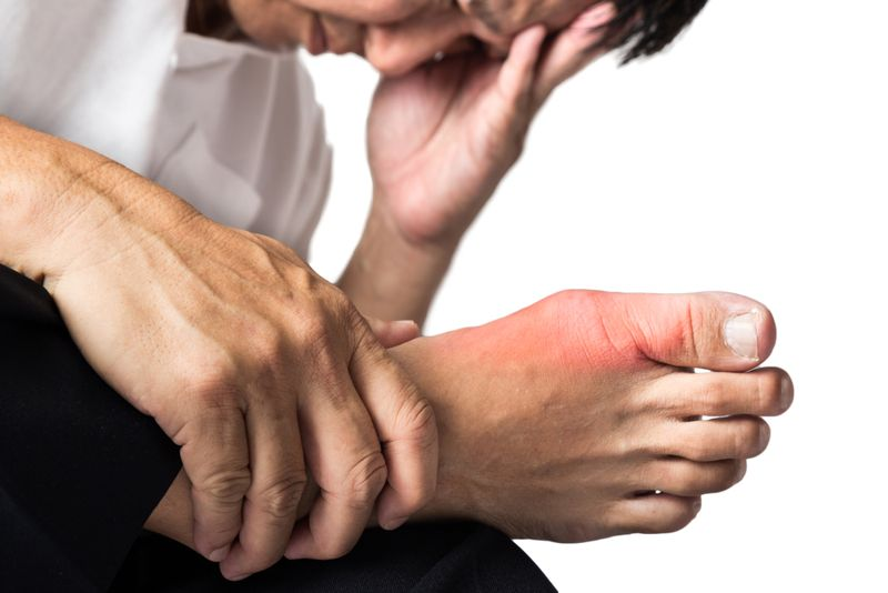 man with sore foot from gout