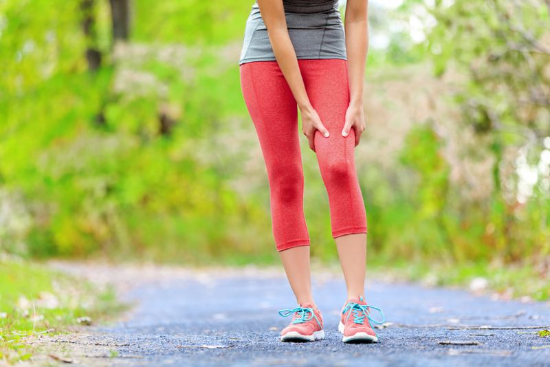 jogging woman has pain in her thigh from fitness