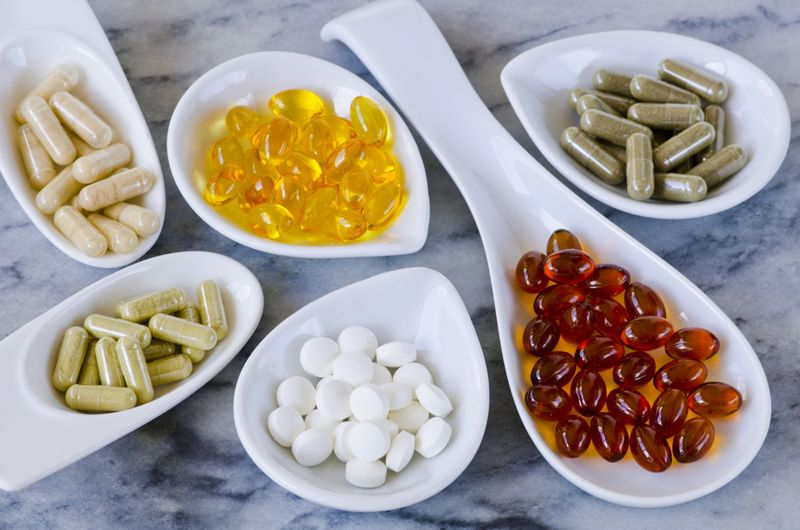 different pills and supplements in glass dishes