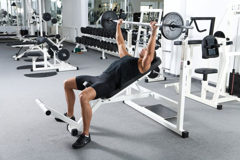 man at the gym doing an incline bench press