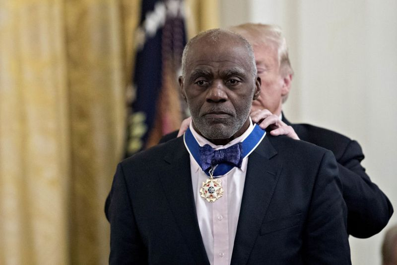 Alan Page, former professional American football player, is presented the Presidential Medal of Freedom by U.S. President Donald Trump, during a ceremony in the East Room of the White House in Washington, D.C., U.S., on Friday, Nov. 16, 2018. Trump awarded the nation's highest civilian honor to an eclectic group of seven recipients including living political allies and long-dead American icon and also political figures with close ties to the president.