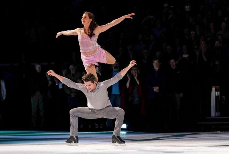 NASHVILLE, TENNESSEE - NOVEMBER 18: Scott Moir and Tessa Virtue skate at the Scott Hamilton & Friends Nashville Ice Show at Bridgestone Arena on November 18, 2018 in Nashville, Tennessee.