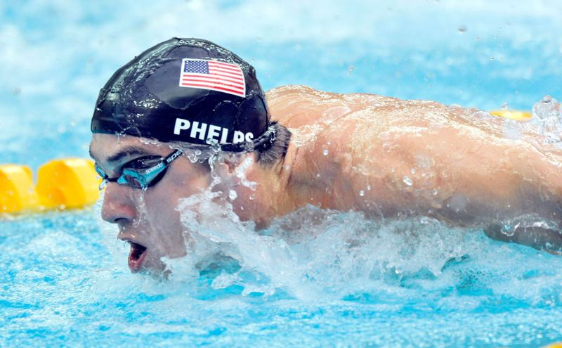 Michael Phelps on his way to winning gold in the 100m Butterfly at the Summer Olympic Games in Beijing China 16th August 2008.