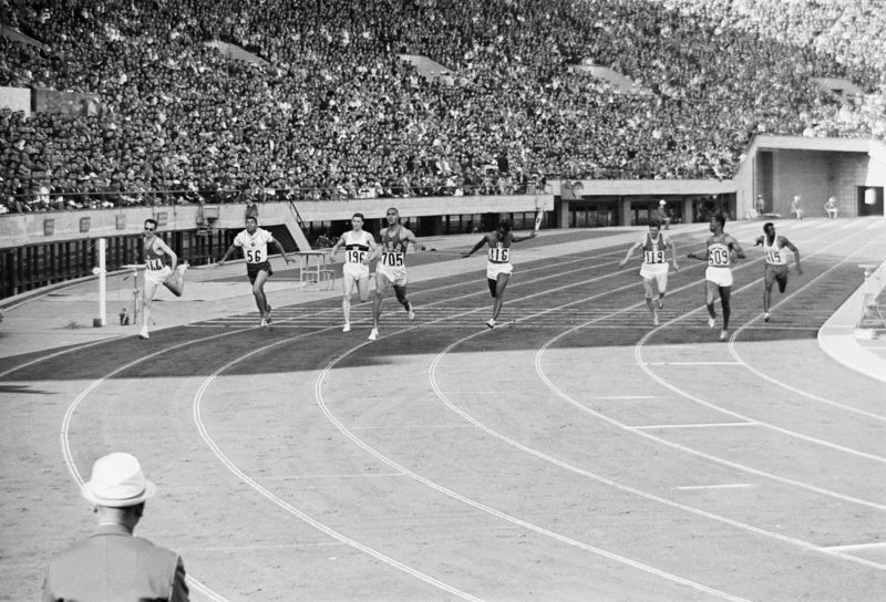Henry Carr #705 of the United States wins the second Semi-Final of the Men's 200 metres race from Livio Berruti of Ital, Edwin Roberts of Trinidad and Tobago and Harry Jerome of Canada on 17th October 1964 during the XVIII Summer Olympic Games at the National Stadium in Kasumigaoka, Shinjuku, Tokyo, Japan. (