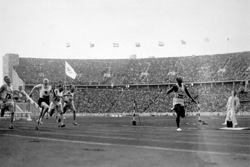 Jesse Owens (1913 - 1980) of the USA (right) crosses the finishing line to win the 100 metres at the 1936 Olympics in Berlin. He won three other gold medals, in the 200 metres, 4 X 100 metres relay and long jump.