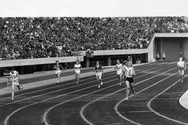 17th October 1964: Betty Cuthbert of Australia (No.12) crosses the finish line to win the 400 metres final at the 1964 Tokyo Olympics. Ann Packer of Great Britain (left) won the silver medal.