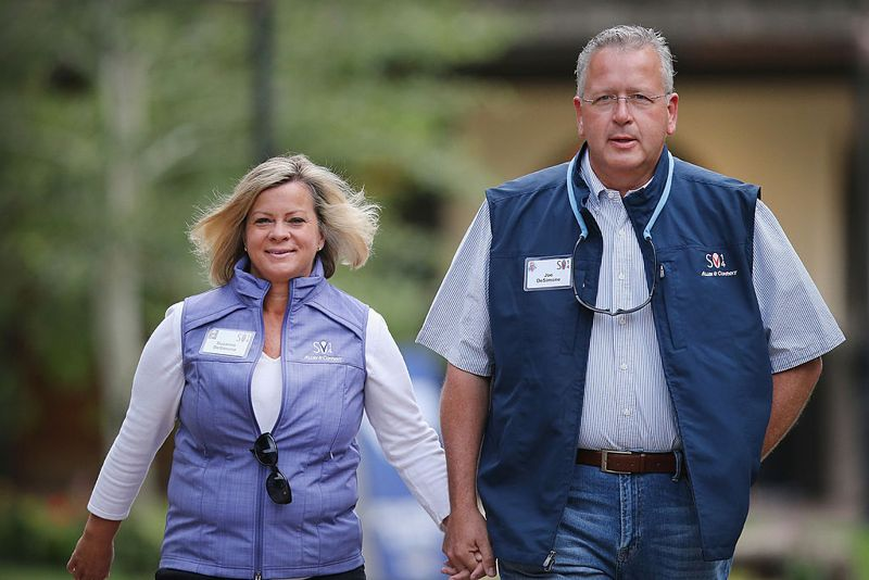Joe DeSimone (R), professor of chemistry at The University of North Carolina at Chapel Hill, walks with Suzanne DeSimone at the Allen & Company Sun Valley Conference at the Sun Valley Resort on July 12, 2014 in Sun Valley, Idaho. Many of the world's wealthiest and most powerful executives from media, finance, and technology attend the week-long conference which is in its 32nd year.