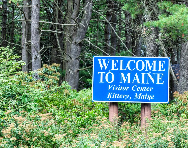 """Maine USA expressway highway roadside welcome sign with the text: """"WELCOME TO MAINE Visitor Center - Kittery, Maine""""."""