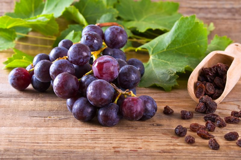 Grapes on a wooden backdrop