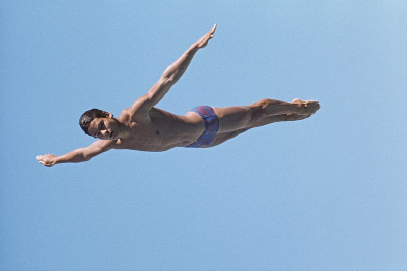 Olympic diver Greg Louganis of the United States performs a practice dive on 1st December 1984 in Los Angeles, California, United States.