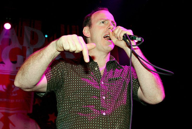 """LAS VEGAS - OCTOBER 21: Bad Religion singer Greg Graffin performs during the first concert held at the newly opened Empire Ballroom October 21, 2005 in Las Vegas, Nevada. The punk rock band is touring in support of the album """"The Empire Strikes First."""""""