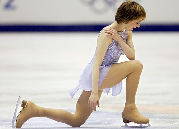 SALT LAKE CITY, UNITED STATES: US Sarah Hughes performs kneels on the ice during the women's free program of the figure skating event at the Olympic Ice Center, 21 February 2002 during the XIXth Winter Olympics in Salt Lake City.