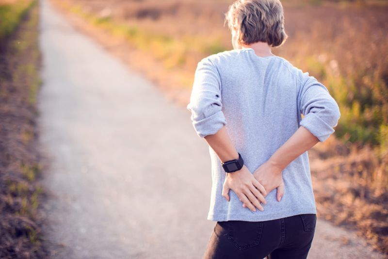 woman walking outside with hip pain