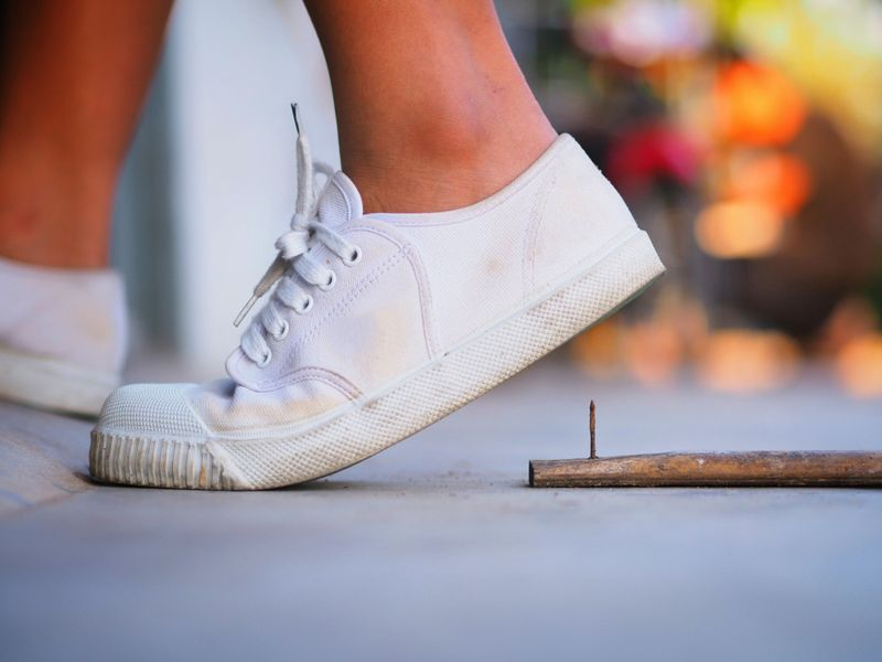 person about to step on a nail; tetanus concept