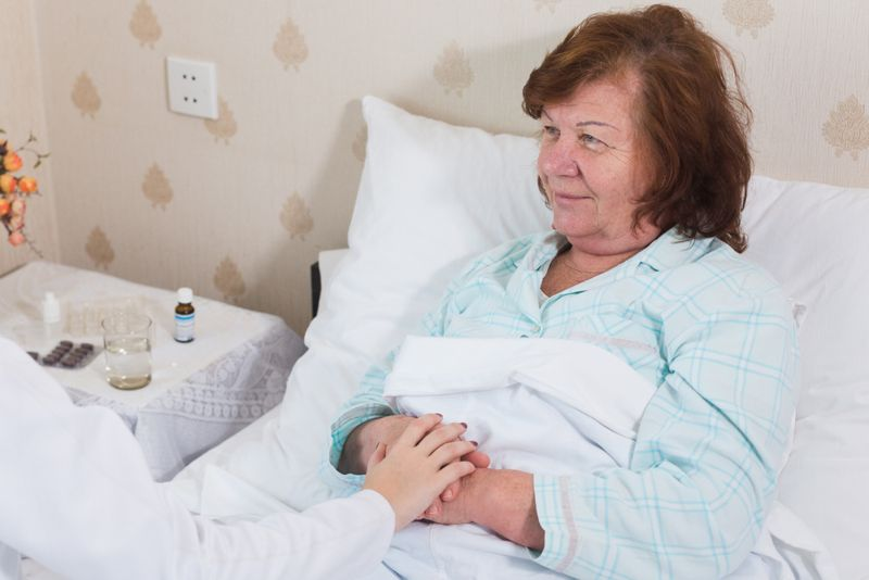 older woman with home care doctor recovering