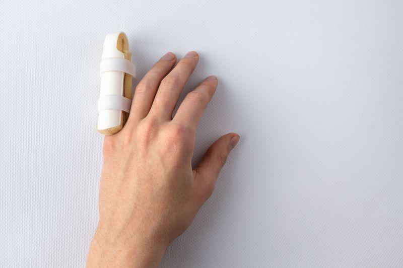 image of a splint on a broken pinky finger