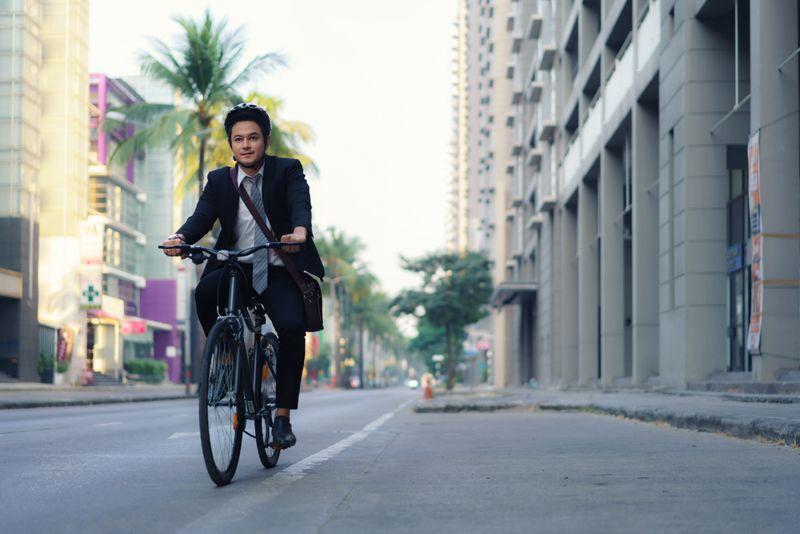 man riding his bicycle to work