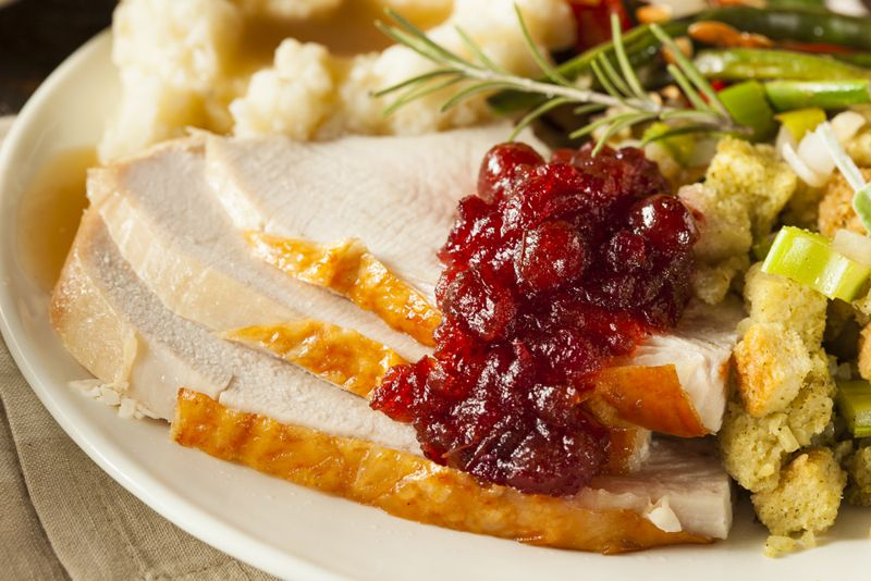 turkey dinner plate with turkey, cranberries and stuffing