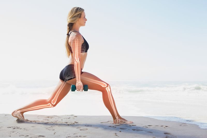 woman working out on beach with bones highlighted
